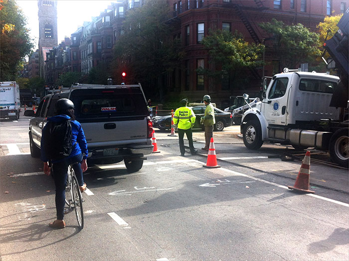 Boston officials direct bikes and cars through the traffic.